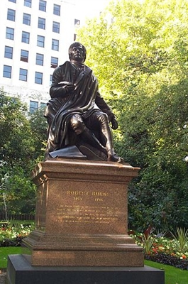 The statue of Robert Burns in Embankment Gardens, London.